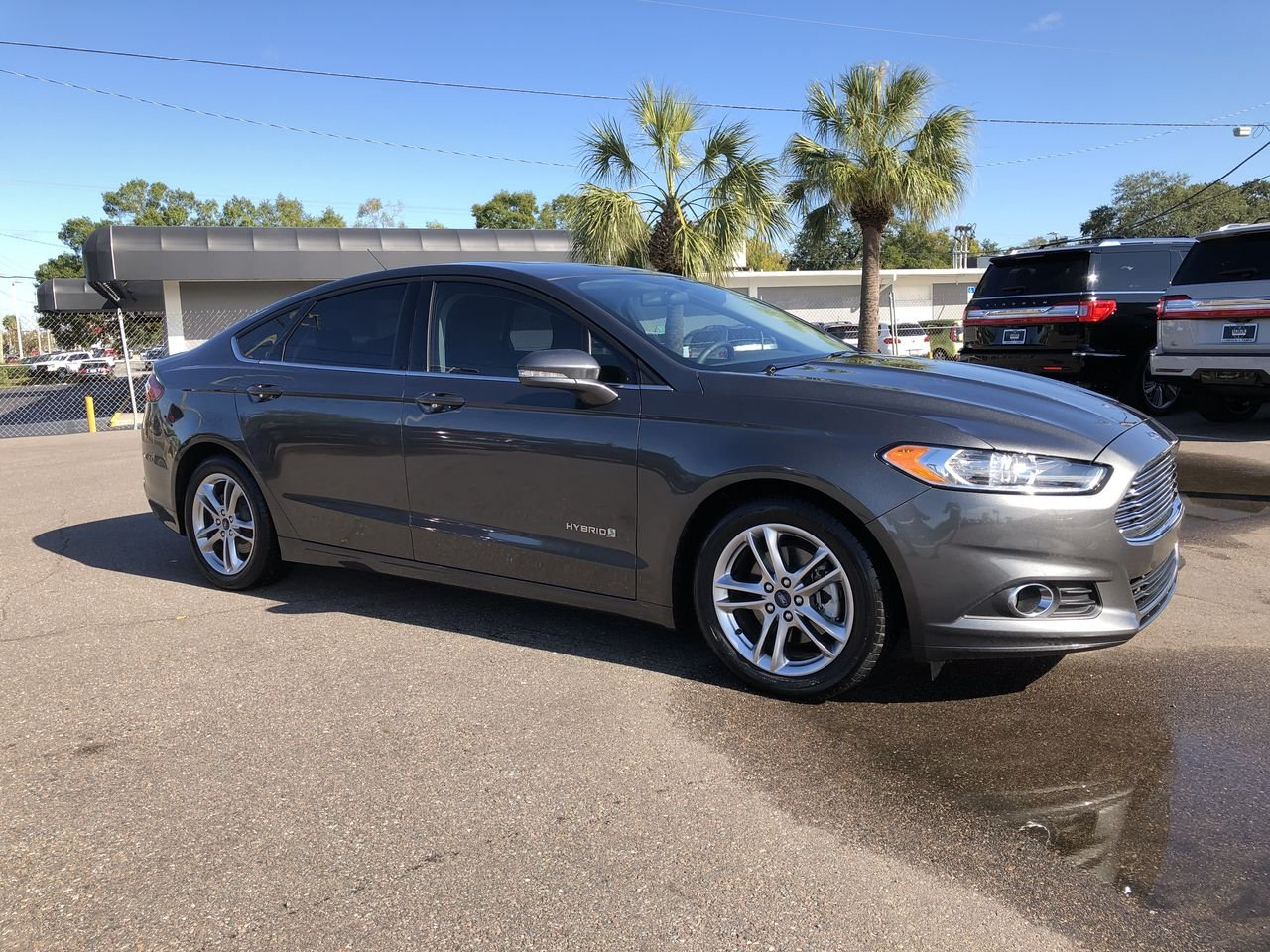 Pre owned 2015 ford fusion se hybrid